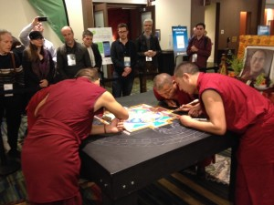 Tibetan monks work on a sand sculpture at the Wisdom 2.0 conference in San Francisco
