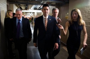 Rep. Ryan walks to a meeting. (NYT photo)