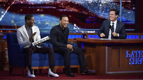 "Stephen Colbert, right, with bandleader Jon Batiste, left, and guest John Legend on CBS' ""The Late Show."" (CBS)"