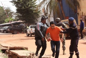 A Mali hostage is helped to safety. (Star-Tribune photo)