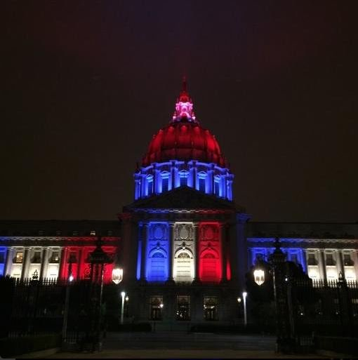 San Francisco City Hall, lit in the colors of the French flag.