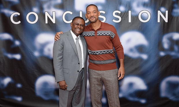 Will Smith, right,  and the real-life Dr. Bennet Omalu