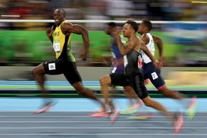 Usain Bolt wins the 100 meter race at the Olympics. (Cameron Spencer/Getty Images)
