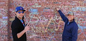 Fans outside Wrigley Field where the names of generations of Cubs faithful are listed. (AP photo)