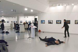 The slain Russian ambassador to Turkey and his assailant. (NYTimes photo)