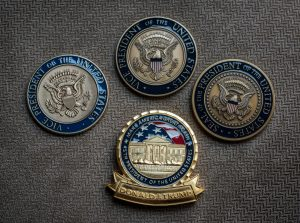 Comparing Presidential coins. Which would you want? (Washington Post photo)