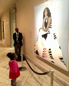 Two-year-old Parker Curry admires Michelle Obama's portrait.
