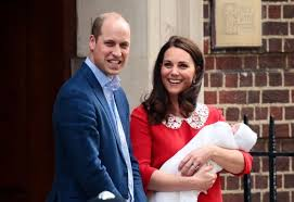 The Duke and Duchess of Cambridge with Prince Louis. How can she look this good? (AP Photo)