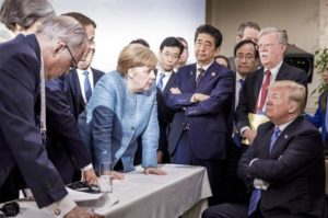 German Prime Minister Angela Merkel explains it all to Mr. Trump.